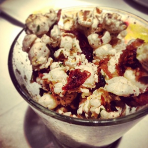 The popcorn was studded with a generous portion of shredded duck confit.
