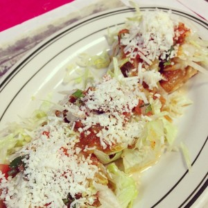 The sopes at La Villa Taqueria were more traditional, fried masa fritters topped with chicken and lettuce.
