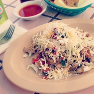The sope at Taqueria del Mar was piled high with shredded chicken and cabbage.