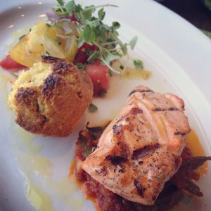 The daily catch highlights different seafoods, like salmon paired with an heirloom tomato and pickled watermelon rind salad.
