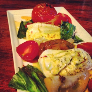 Nothing says summer like a plate of ripe, red heirloom tomatoes. The tomatoes and mozzarella at Mundaka takes the top spot on my list for best in town.